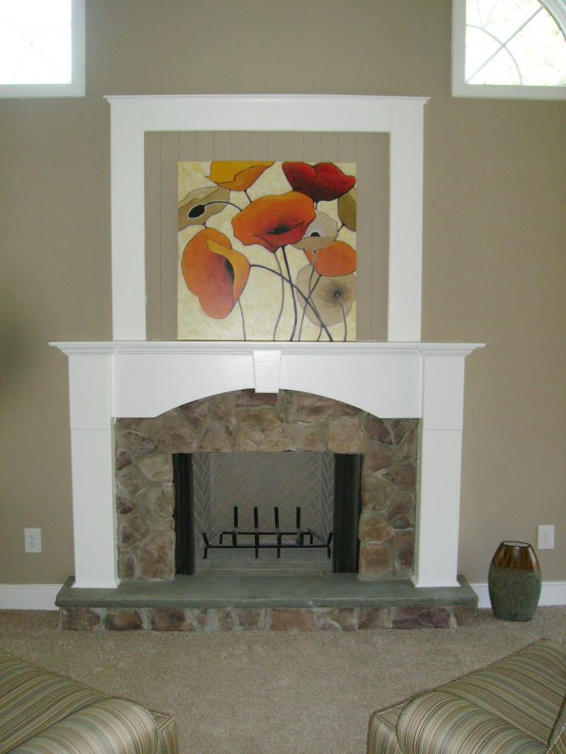 CUSTOM STONE AND WOOD FIREPLACE